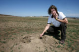 Barbara Spagnuolo (cq) shows the dig marks near a former prairie dog hole Wednesday April 26,...