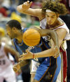 CDA119 - Cleveland Cavaliers' Anderson Varejao, right, from Brazil, bats the ball away from...