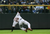 Barry Bonds makes an akward catch in left field in the 2nd inning of the Colorado Rockies against...