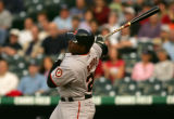 Barry Bonds hits a fly ball for the final out in the 1st inning of the Colorado Rockies against...