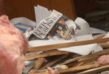 (Granby, CO, Shot on 060804) A copy of Editor and Publisher Magazine lies in the remains of the...
