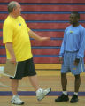 Denver Nuggets point guard Earl Boykins, right, listens to Nugget's head coach George Karl, left,...