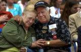 "FLTAM101 - Dalia, left, and Mariano Lemus Sr. remember their son Mariano ""Rocky"" Lemus..."