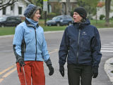 Deborah Cornelius (cq) and her friend Ana Hill (cq), left to right didn't let the cold damp...
