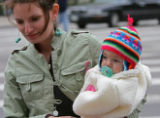 Carolyn Anello carries her bundled up baby Livia Anello at the corner of Broadway and 17th Monday...