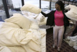 Yvonne Kelly, Denver, Colo., sorts through pillows trying to find down pillows. The Embassy Suites...