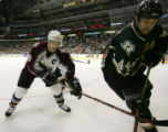 Avs Joe Sakic (L) tries to keep Stars Jason Arnott (44) from the puck in the third period during...