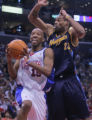 Los Angeles Clippers guard Sam Cassell, left, escapes a block attempt from Denver Nuggets' forward...