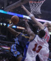 Denver Nuggets forward Carmelo Anthony, left, is defended tightly by Los Angeles Clippers' players...