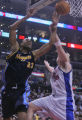 Denver Nuggets center Marcus Camby  tightly by Los Angeles Clippers' player Chris Kaman, right, in...