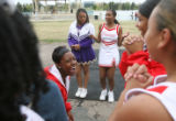 East High School senior Whitney Warren (cq) laughs with friends as (at rear center) fellow cheer...