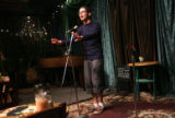 "Jacob Rosen (cq), 18, ""slams""  his original poem ""Heaven Outside the Cube"" at..."