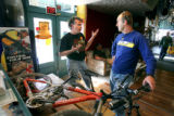 Over the Edge Sports owner and general manager Troy Rarick (cq, left) talks with mountain biking...