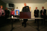 City of Aurora Police Chief Daniel Oates, center,  and Arapahoe County D.A. Carol Chambers, far...