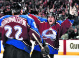 Colorado Avalanche Teemu Selanne celebrates after assisting Steve Konowalchuk in scoring the first...
