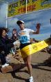Lisa Goldsmith, 40, of Nederland, Colo.,  cross the finishline of  the the Pikes Peak Ascent to...