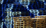 Palettes sit stacked in a yard at IFCO Systems in Commerce City on Thursday April 20, 2006....