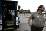 Contract bus driver Michael Jerrod, cq, of First Transit takes a break from his RTD route Monday...