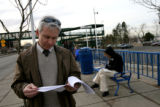 Rich Murphy, cq, reads his paper work as he waits for his bus Monday Apr. 3, 2006 at the...