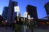 Mark Gonzales (cq) leads a group of striking bus drivers on the picket line at the Market Street...