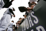 CMS152 Colorado Rockies pitcher Brian Fuentes, #40, left, signs autographs before Colorado's game...