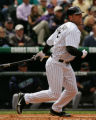 CMS327 Colorado Rockies batter Matt Holiday hits a single off Arizona Diamondbacks starting...