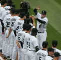 JPM317  Colorado Rockies starting right fielder Brad Hawpe, #11, greets teammates during...