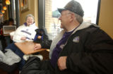 L to R: Rockies fan Judy Taggart (cq) and her friend Bradley Kidwell (cq) sit in a cafe near Coors...