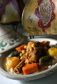 Lamb shank with vegetables tajine at Cafe Paprika in Aurora. (JUDY DEHAAS/ROCKY MOUNTAIN NEWS)
