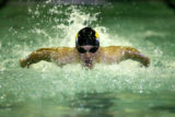 Chris Wiggins, senior, Arapahoe swims the Boys 100 yard Butterfly, Tuesday Apr. 18, 2006 in the...