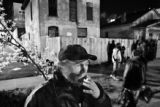 John Fiedler, 57, smokes while waiting for the St. Francis Center to open at 2323 Curtis Street...