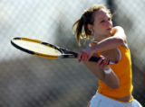 Cherry Creek senior tennis doubles player Julie Swinehart (cq, No. 4) , 17, practices Tuesday...