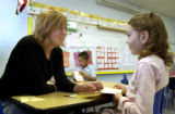 (DENVER Colo., January  27, 2005)  Kindergarten teacher Jenny Matthews  listens  student Raquel...