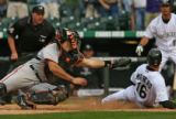 Rockies Eli Marrero slides past the tag of Giants catcher Mike Matheny in the bottom of the 10th...