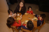 (DENVER, Colo., January 12, 2005)  Perla Flores, 16, top center, feeds her younger siblings a...