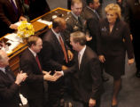 (DENVER, CO., JANUARY 13, 2005)  Colorado Gov. Bill Owens, center, shakes hands with U.S. Attorney...