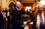 (DENVER, Colo., January 13, 2005) United States Senator Ken Salazar (center) shakes hands with...