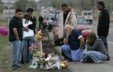 On April 24, 2006, in Brighton, Colo. friends and acquaintances stopped by a make shift memorial...