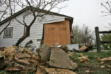Pieces of a house lay scattered in the yard at 1100 Vaughn St. in Aurora Monday morning April 24,...