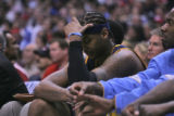 Denver Nuggets forward Carmelo Anthony watches as his team fall behind as he sits on the bench...