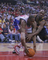Denver Nuggets forward Francisco Elson, right, fights for a rebound against  Los Angeles Clippers...