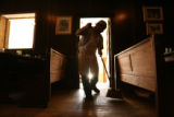 Mexican immigrant Enrique Hernandez, 42, sweeps floors at a restaurant in Telluride, before...