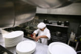 Wiliualdo Lopez (CQ), 16, a native of Mexico, prepares chocolate mouse at a restaurant in...