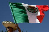Pedro Rodriguez (cq) waves the national flag of Mexico during a pro-immigrant labor demonstration...