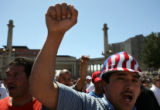 Luis Moreno Castillo (cq) raises his arm while marching at a pro-immigrant labor demonstration at...