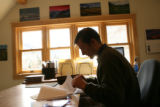 Scott McQuade CEO of Marketing Telluride INC, looks for stats on the Telluride economy in his...