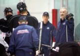 Colorado Avalanche head coach Joel Quenneville (far right) gives instructions during a voluntary...