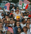 Junior Alcala, 4, a United States citizen sits on top of his fathers shoulders who is here...