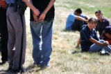 The hands of Illegal immigrant Domicio Vargas, cq, 22, left, are bound by Colorado State Patrol...
