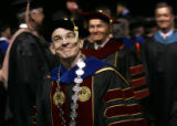 Robert Coombe (cq) smiles at the crowd as he leaves Magness Arena after being inaugurated as...